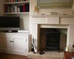 Fireplace and cupboards